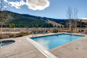 Spend your afternoon après in the outdoor, heated pool with slope views.